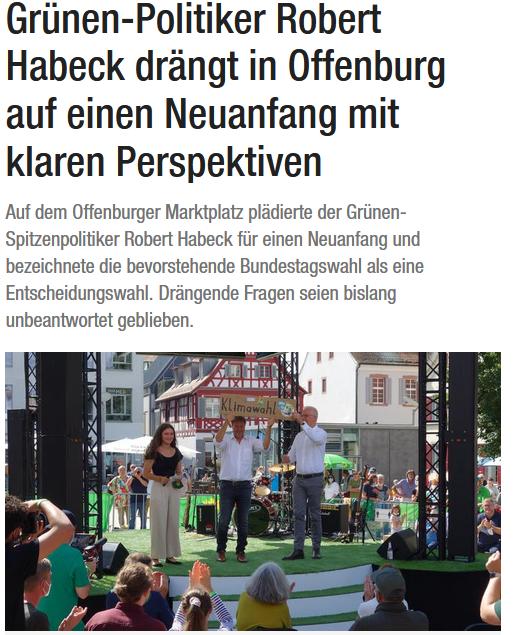Artikel auf der Website der BNN. Auf dem Foto zu sehen sind (v. l.) Elisabeth Schilli, Robert Habeck und Thomas Zawalski auf der Bühne auf dem Offenburger Marktplatz